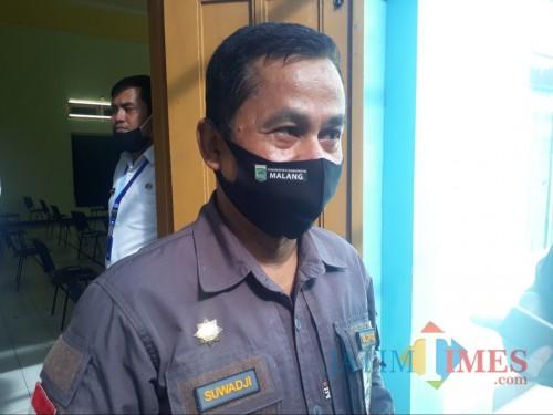 Kepala Dinas Pemberdayaan Masyarakat dan Desa (DPMD) Kabupaten Malang, Suwadji saat dikonfirmasi awak media. (Foto: Tubagus Achmad/MalangTimes)