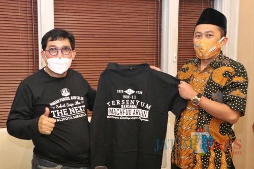 Ketua GP Ansor Surabaya Faridz Afif bersama Machfud Arifin.