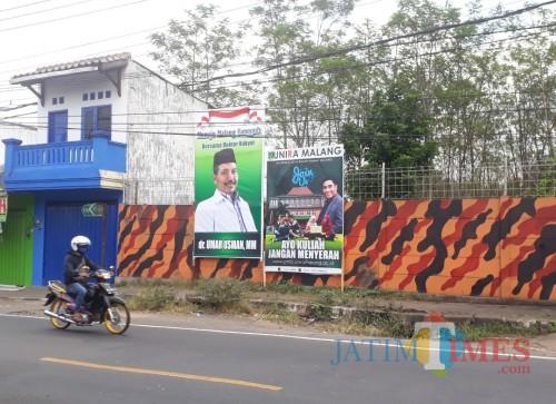 Banner Umar Usman yang telah terpasang di pertigaan Pakisaji tepatnya di seberang Puskesmas Pakisaji, Senin (13/7/2020). (Foto: Tubagus Achmad/MalangTimes)