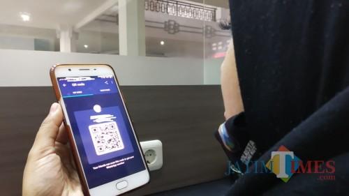 Ilustrasi pembayaran menggunakan barcode. (Pipit Anggraeni/MalangTIMES).