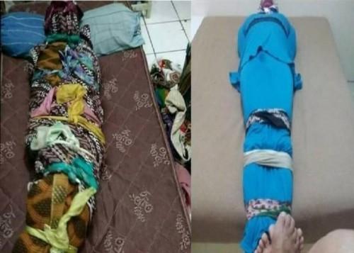 Terduga korban saat diminta membungkus dirinya dengan kain jarik. (Foto: Twitter @m_fikris)