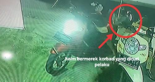 Potongan gambar CCTV saat pelaku beraksi mencuri helm milik karyawan toko di kawasan Kedungkandang (Ist)