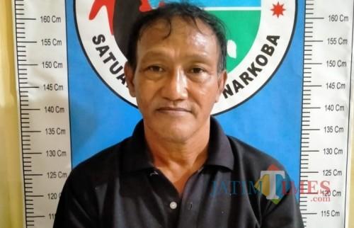 Terlapor saat diamankan di Mapolres Sumenep (Foto: Humas Polres Sumenep for JatimTIMES)