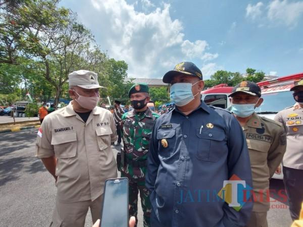 Pjs Bupati Malang, Sjaichul Ghulam saat ditemui awak media usai memimpin apel di Kodim 0818, Kamis (15/10/2020). (Foto: Tubagus Achmad/MalangTimes)