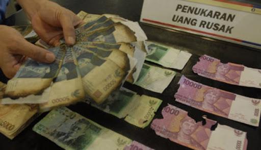 Uang rusak (Foto:  Emitennews)