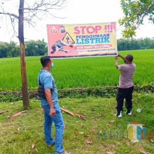 Polisi Pasang Banner Larangan Jebakan Tikus Beraliran Listrik