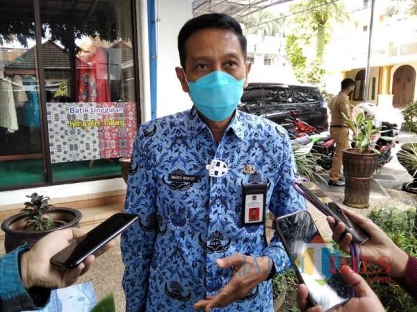 Sekda Kabupaten Malang Wahyu Hidayat saat memaparkan kesiapan pencanangan vaksinasi besok (Sabtu 30/1/2021). (Foto: Dokumen JatimTIMES)