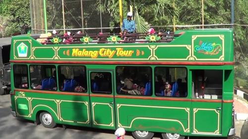Bus Malang City Tour (Macito) saat digunakan keliling kota oleh wisatawan. (Foto: source google).