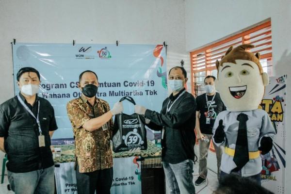 WOM Finance Salurkan Bantuan Pandemi Covid-19 (Foto: Dok JatimTIMES)