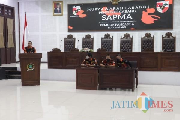 Ketua SAPMA PP Kota Malang, Udte Syahputra (kiri) pada Muscab PP Kota Malang, Senin (4/4/2021) (SAPMA PP Kpta Malang for MalangTIMES)