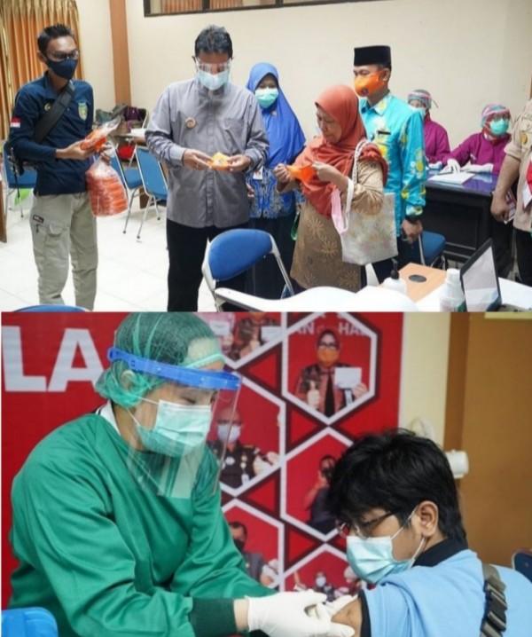 Wali Kota Madiun menyaksikan dan membagikan masker saat proses vaksinasi bagi pedagang dan tenaga upahan (Foto: M. Nashir/MadiunTIMES).