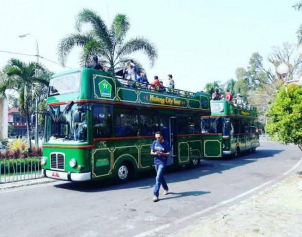 Bus Malang City Tour (Macyto) saat digunakan keliling kota oleh wisatawan. (Foto: source Instagram).