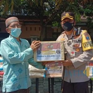 21 Warga Perumahan Bukit Hijau dan Permata Hijau Positif Covid-19, Polresta Malang Kota Salurkan Bantuan