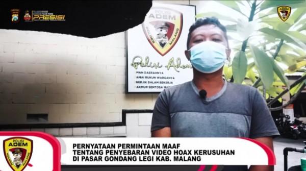 Pelaku pembuat video hoaks saat meminta maaf di Mapolres Malang (screenshot video Instagram @polresmalangofficial)