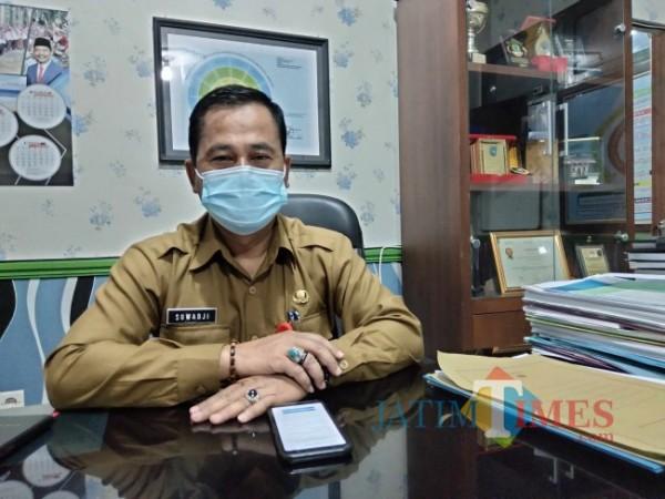Plt Kepala DPMD Kabupaten Malang Suwadji (Foto: Riski Wijaya/MalangTIMES)