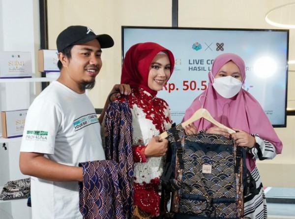 Produk gendongan bayi yang berhasil dilelang untuk membantu pengobatan bayi di Malang. (Foto: Istimewa).
