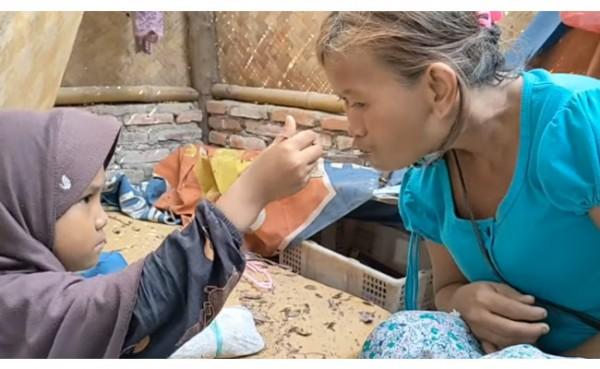 Gadis 7 Tahun merawat sang ibu yang depresi (Foto: YouTube)