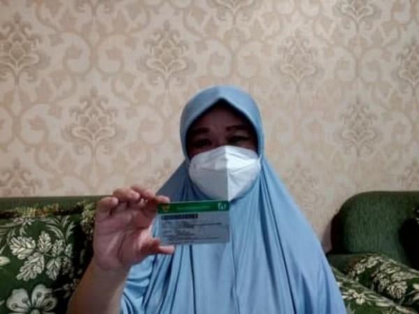Salah satu peserta JKN-KIS bernama Afifah (60) yang telah menggunakan layanan Pandawa dari BPJS Kesehatan. (Foto: Humas BPJS Kesehatan Cabang Malang)