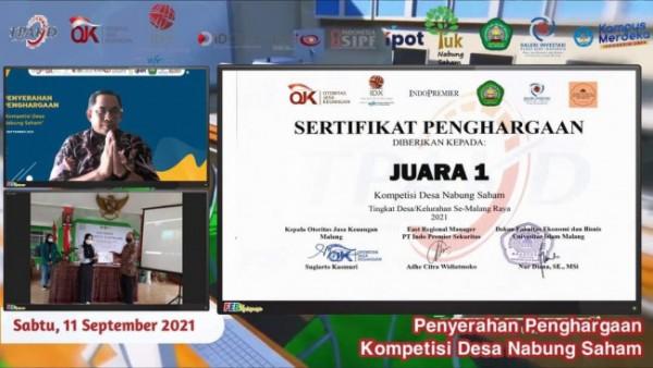 Pengumuman juara satu bagi Desa Sumbersuko, Kecamatan Wagir, Kabupaten Malang oleh FEB Unisma, BEI, OJK dan Indopremier Sekuritas. (Foto: Humas Unisma)
