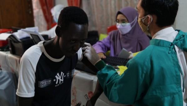 Pelaksanaan Vaksinasi Covid-19 yang digelar DPC PKS Kecamatan Blimbing. (Foto: Istimewa).